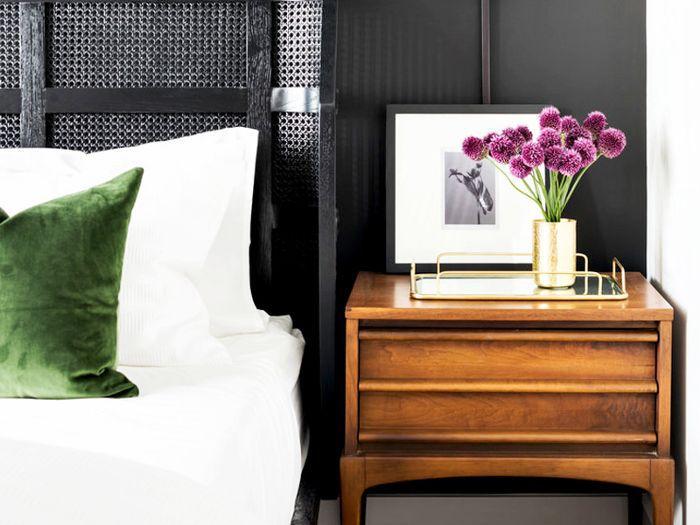 bedroom nightstand with purple flowers
