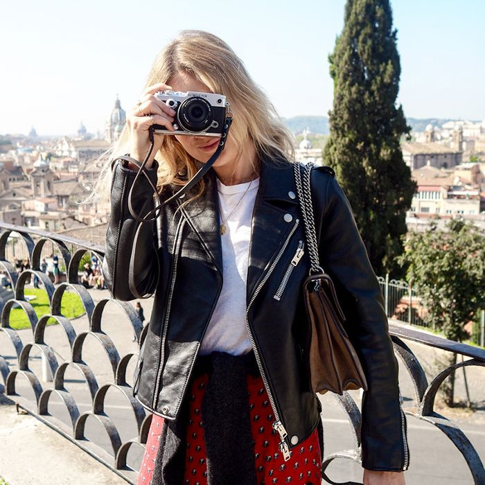 a woman taking a picture with a camera