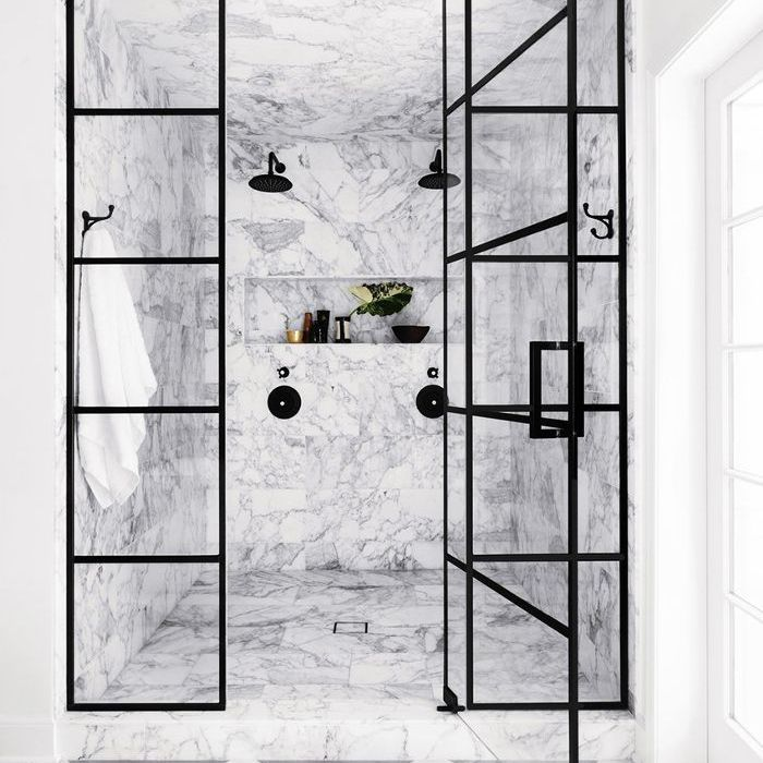 marble bathroom with black-and-white floor tile