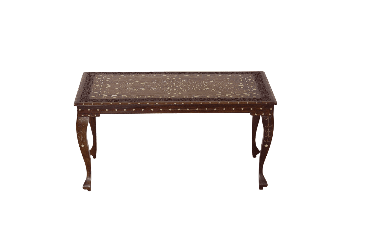 A hand-carved brown dining table with curved legs and bone inlay detailing throughout.