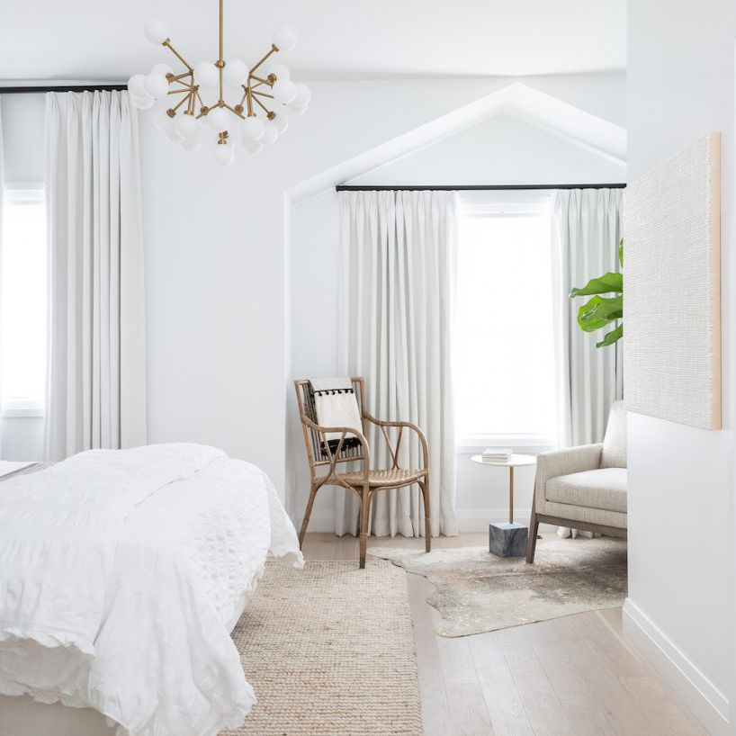 White bedroom with modern chandelier
