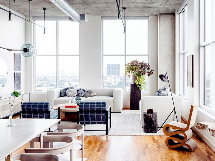 a chic loft living room and dining area