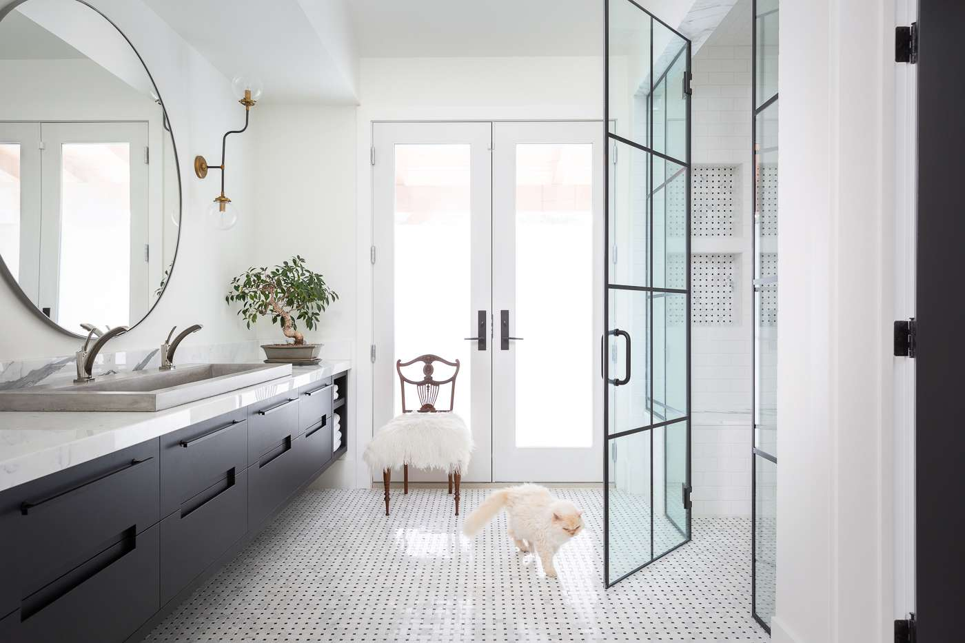 A bathroom featuring a double vanity with ample counterspace