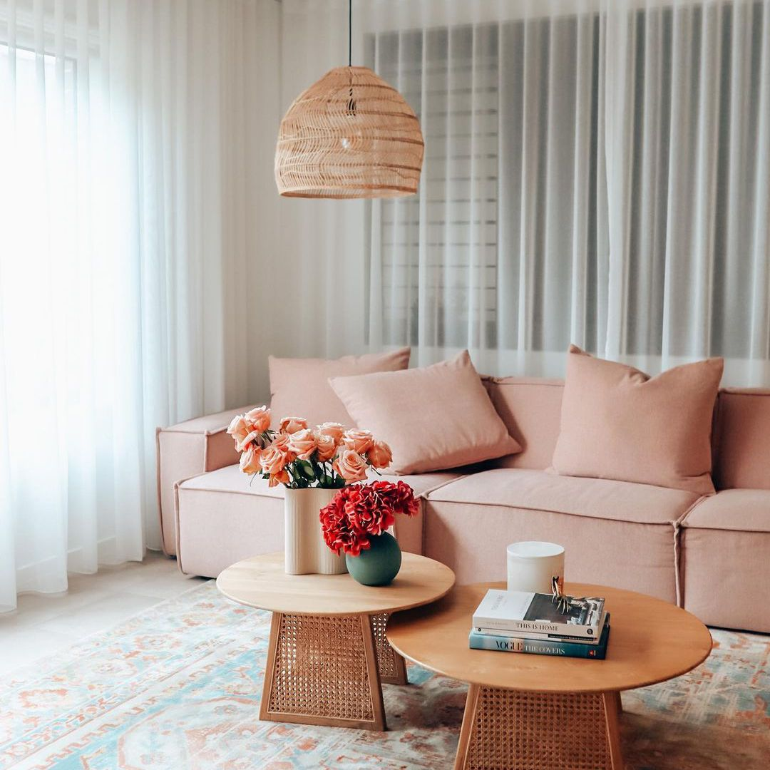 Living room with blinds and sheer curtains.