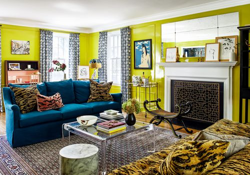 Chartreuse living room with animal print furniture.