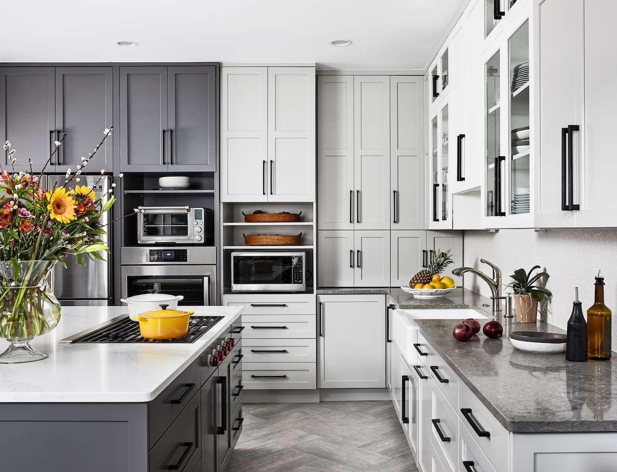Gray kitchen with white cabinets