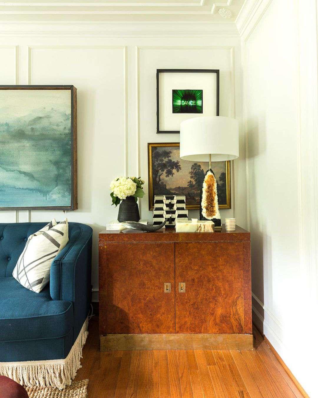 Burl wood dresser with decorative accents.
