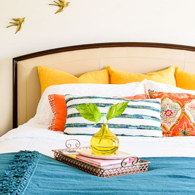 Bright bedroom with yellow accents