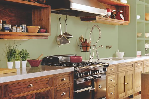 Beautiful wood kitchen with Olive Spring paint on walls.