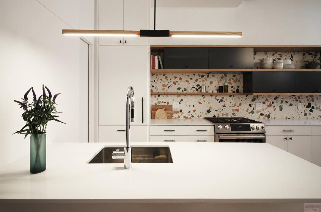 Black and terrazzo kitchen