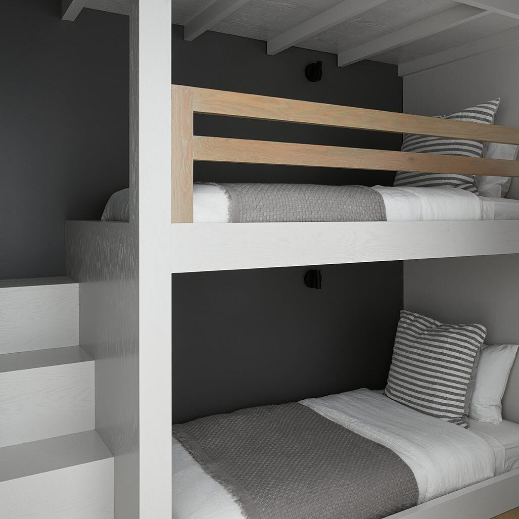 Gray and white bunk beds with dark gray accent wall