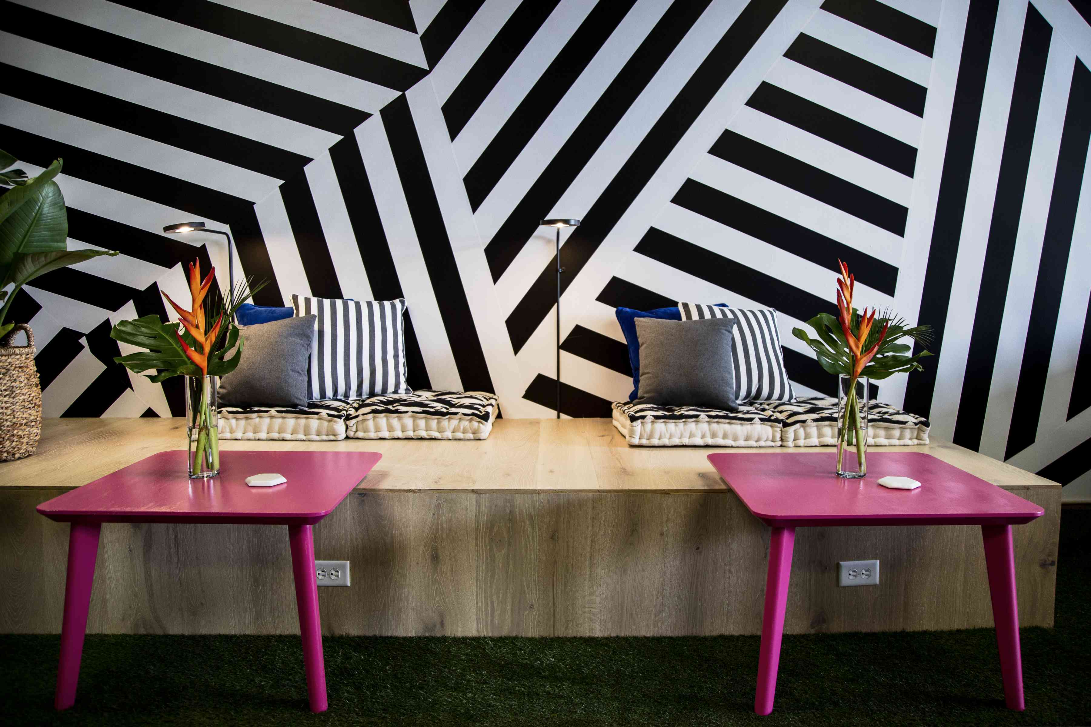 Office area with abstract black-and-white wall mural.