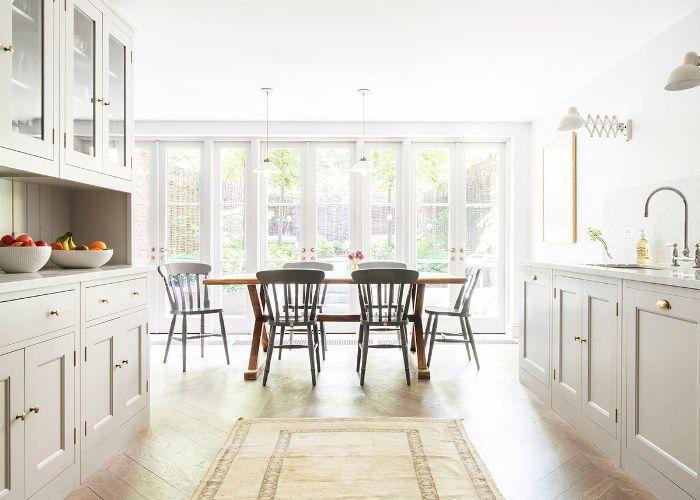 Herringbone hardwood floors in dining room and kitchen