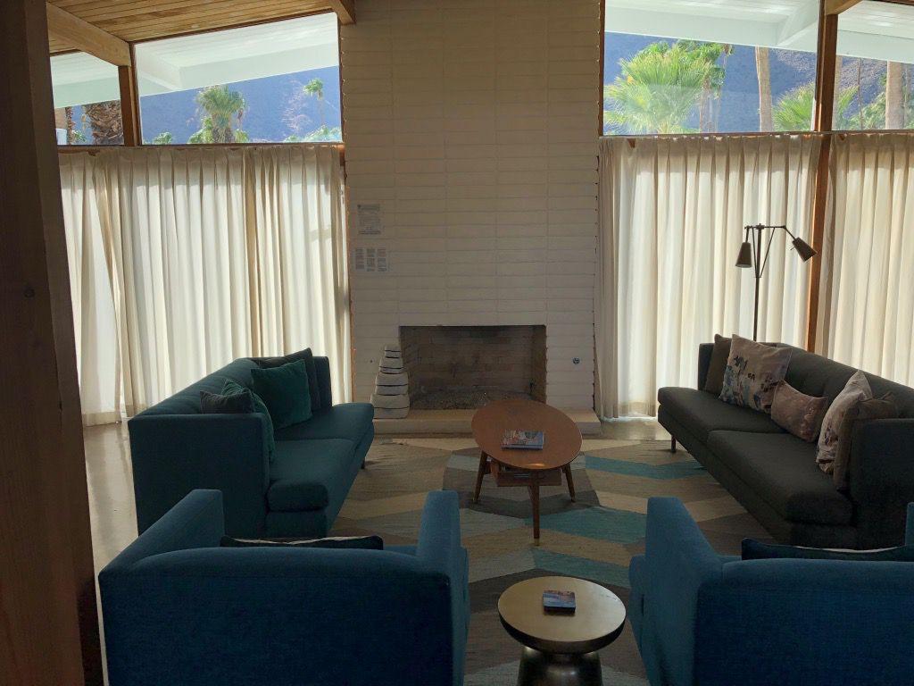 Before shot of bland midcentury living room.