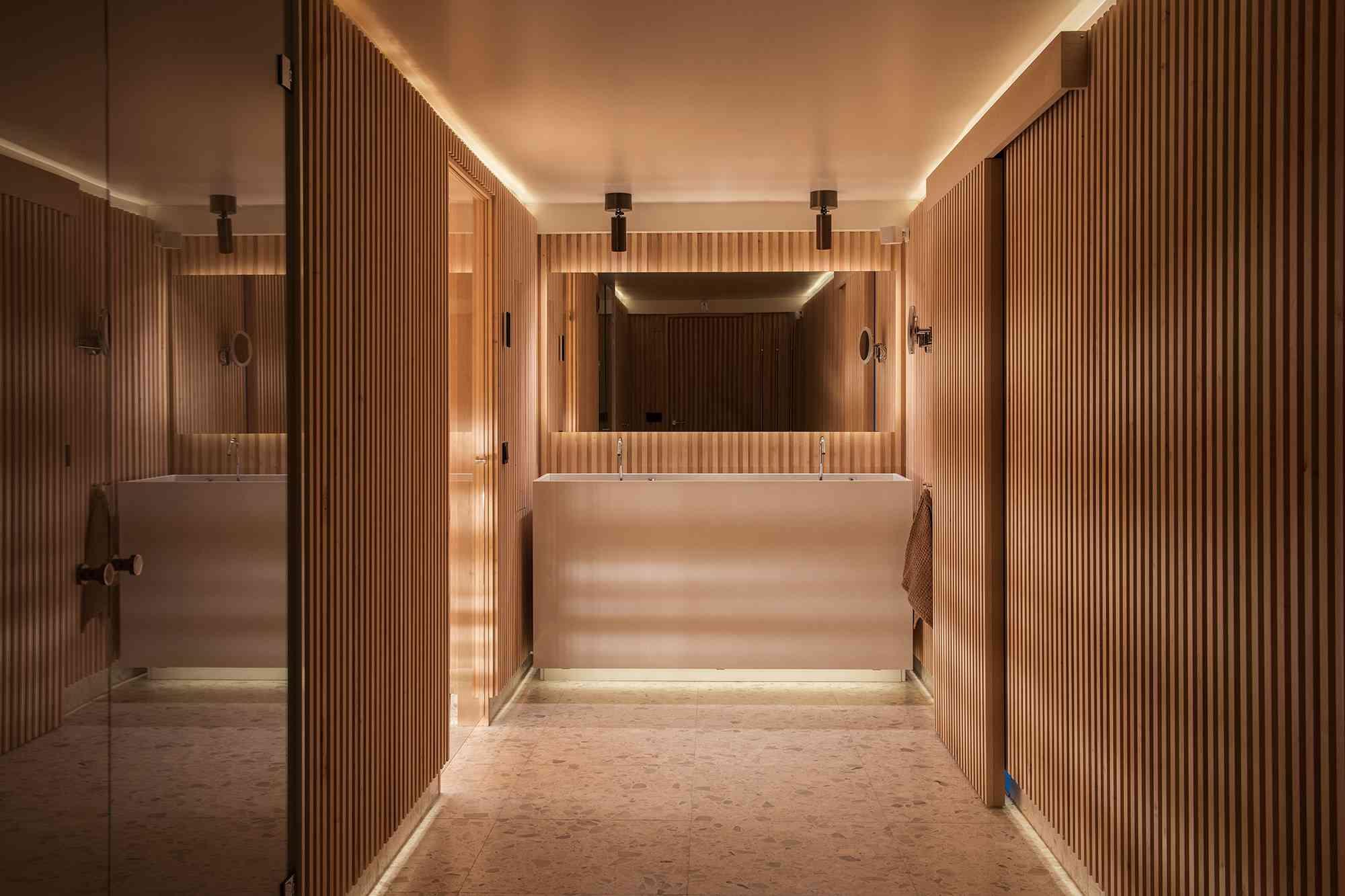 Wood slat panel bathroom with accent lighting