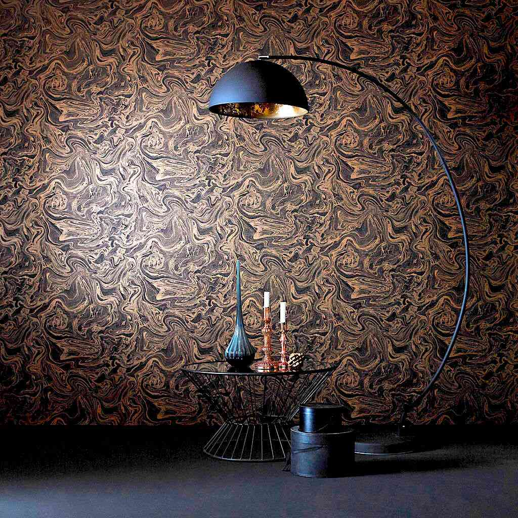 Marbled brown and black wallpapered wall with a black arch lamp and a vignette with vases.