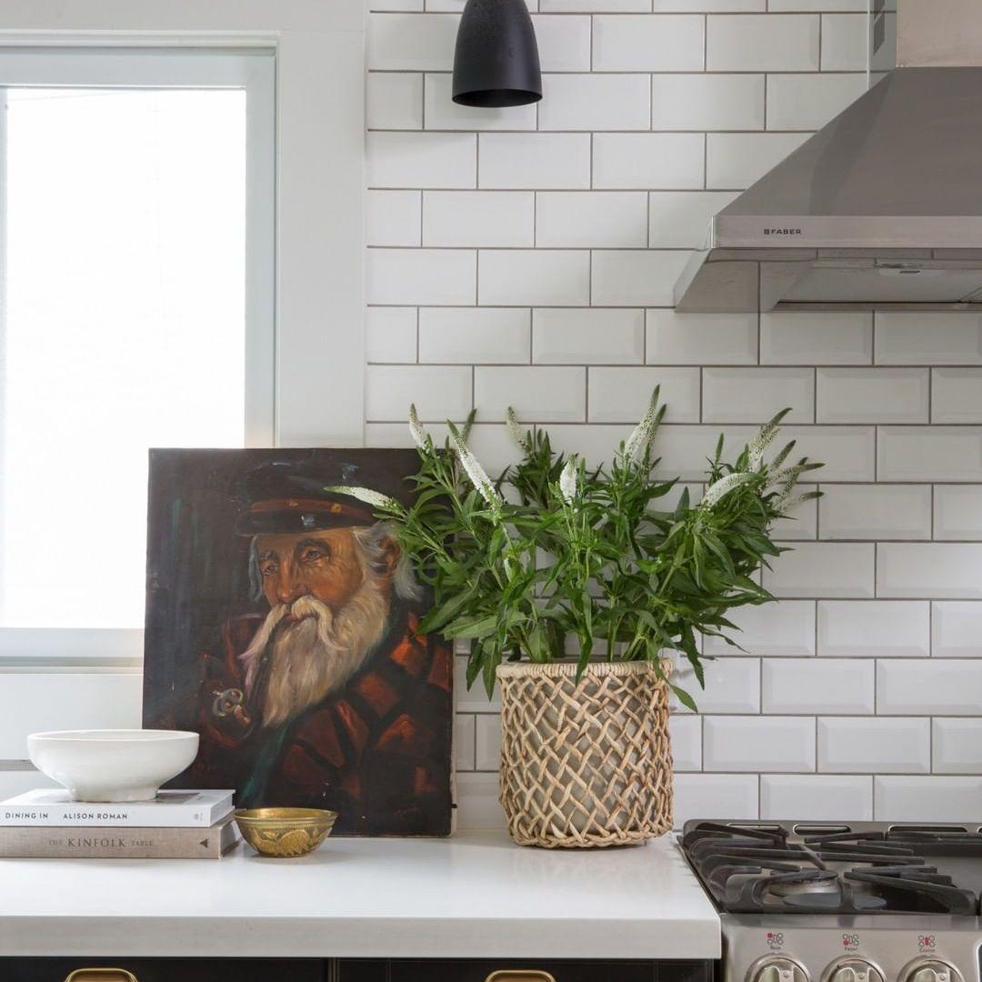 Black kitchen with beveled subway tiles
