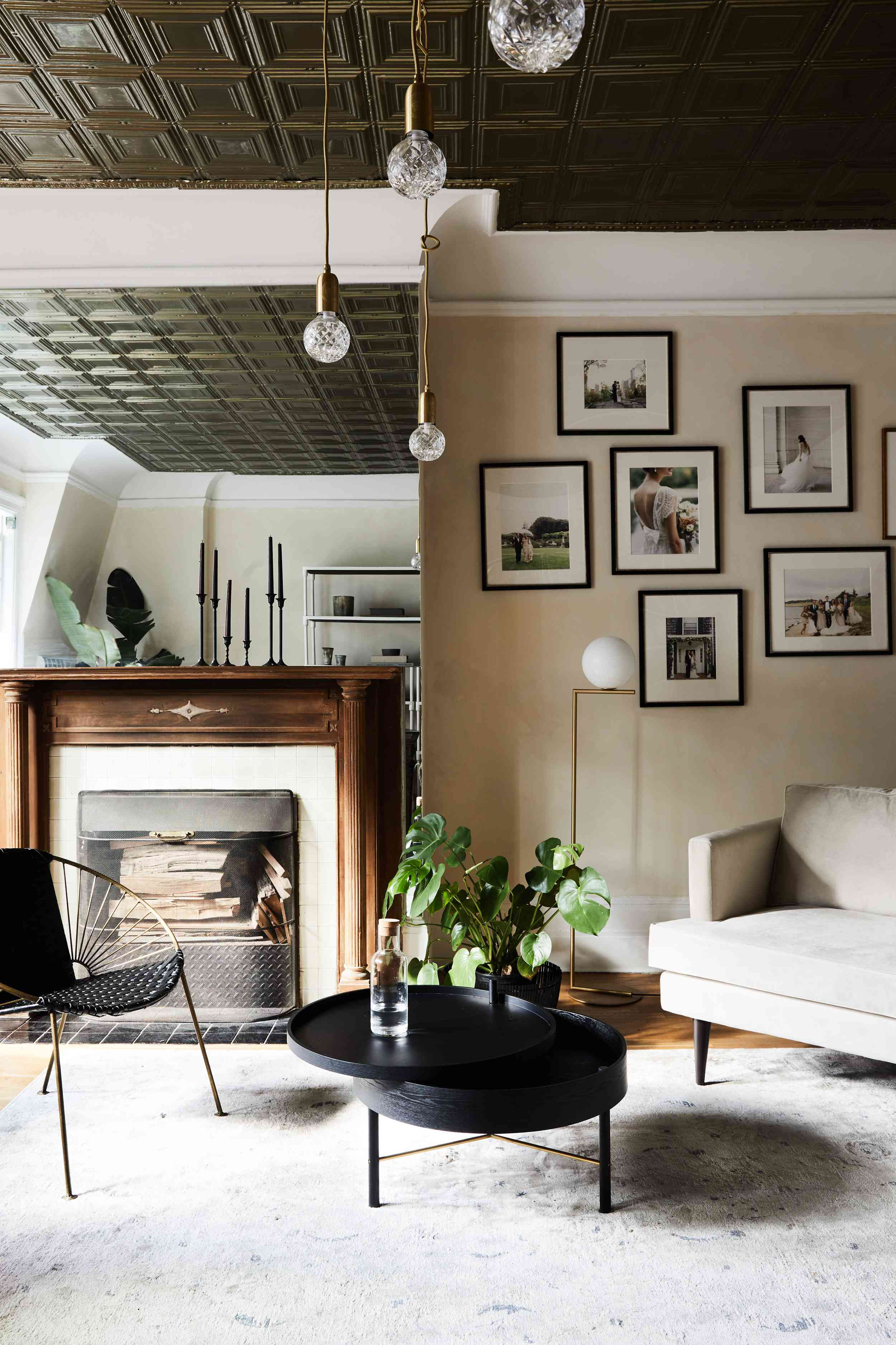 Living room with dark tin ceiling and eclectic furniture