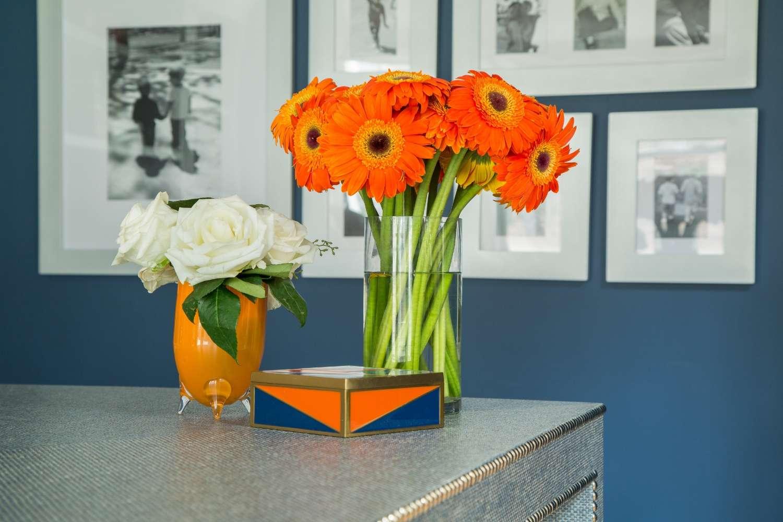 Close up of orange flowers on desk.