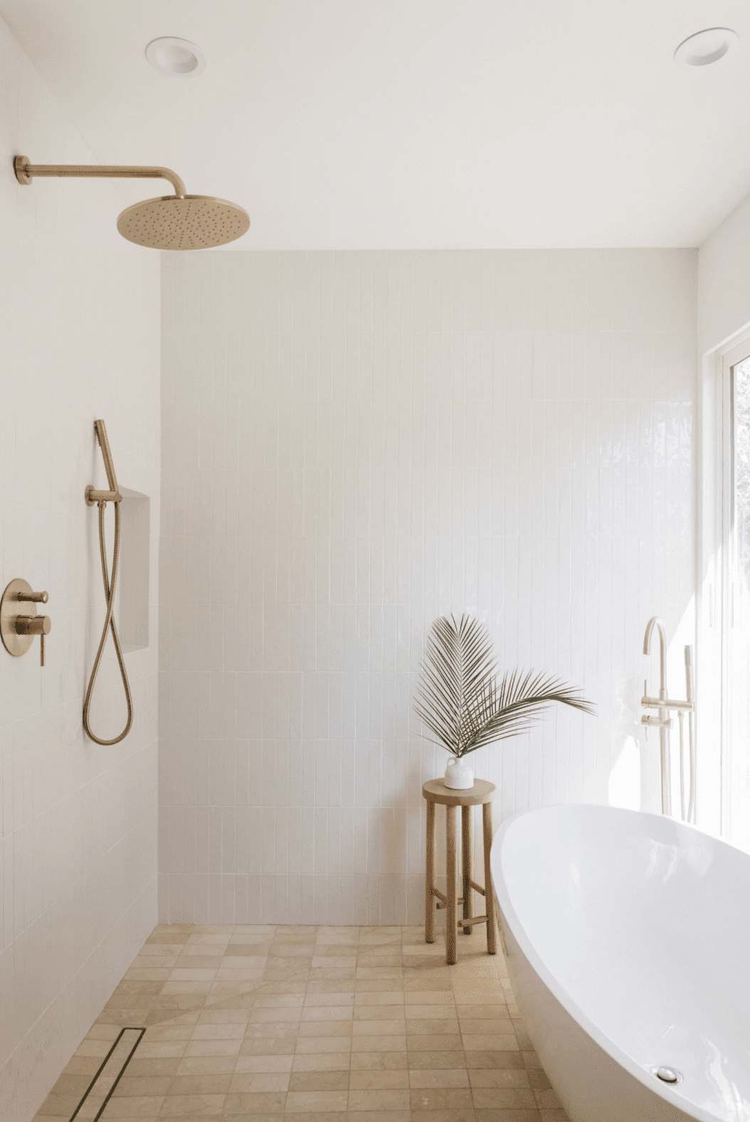A large shower with a freestanding tub inside it