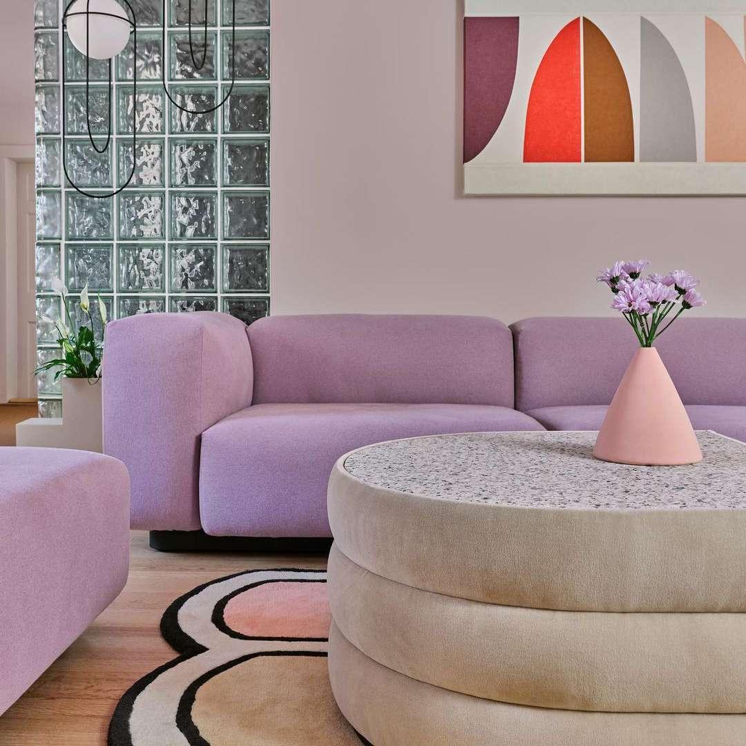 80's inspired living room with modular purple sofa