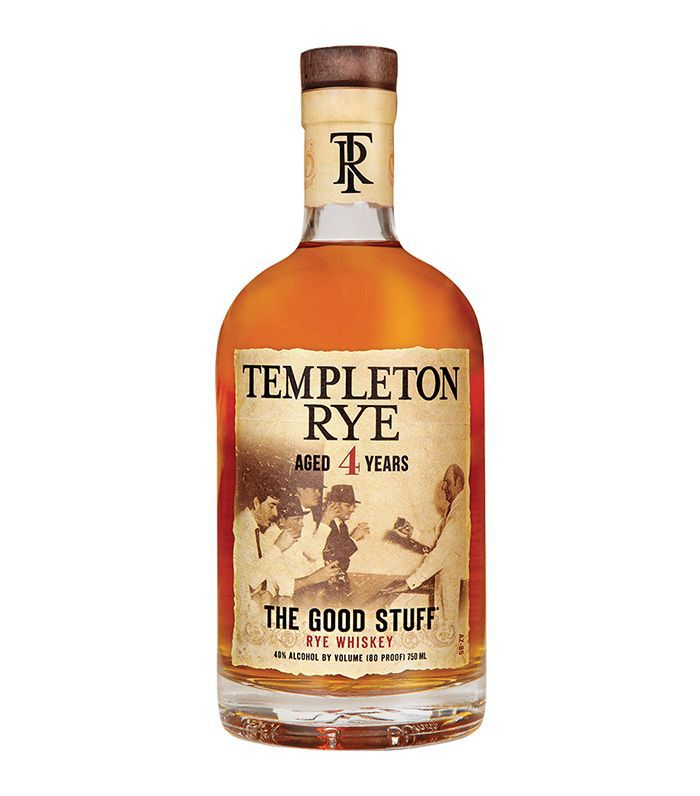 A glass bottle of Templeton Rye Whiskey with a brown label and cork top.