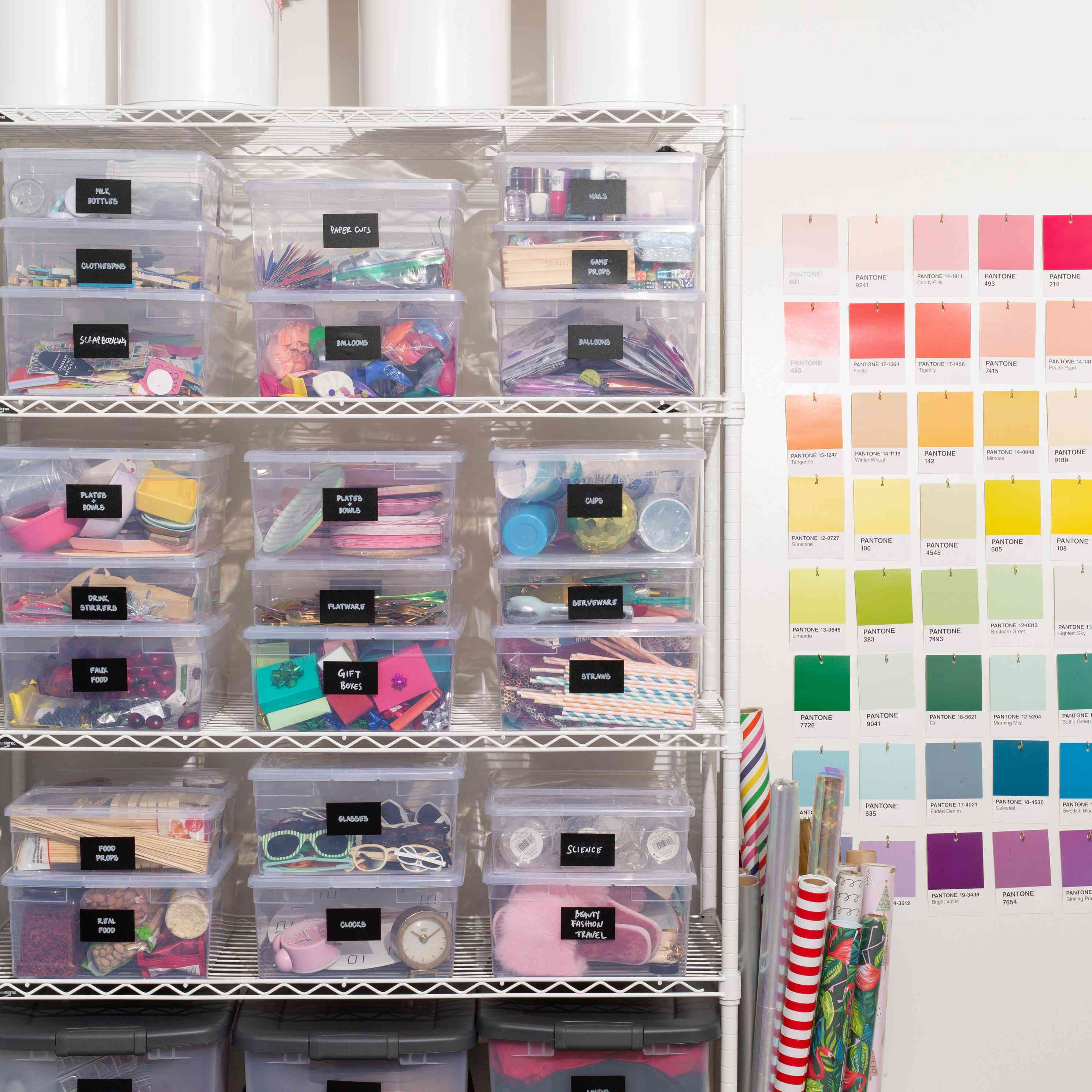 A craft room with a paint swatch wall