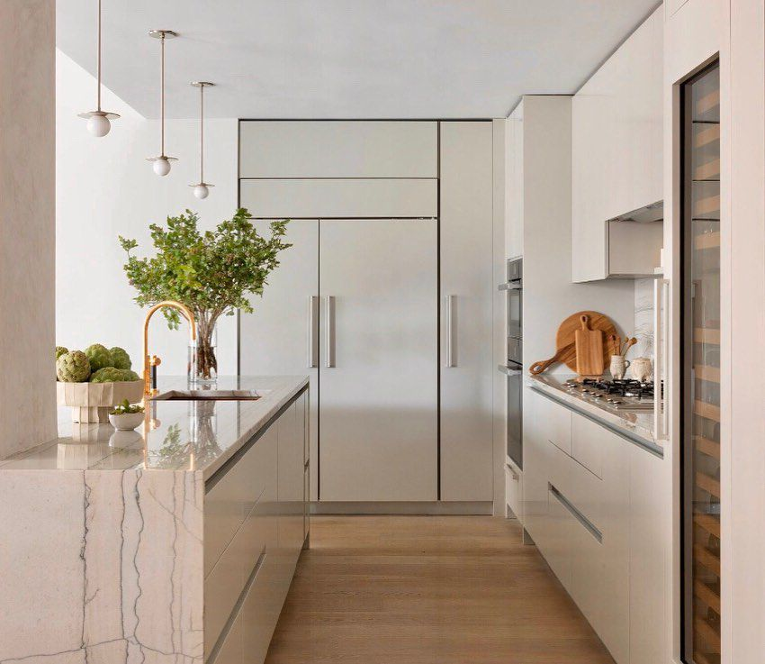 best kitchen ideas - warm kitchen with waterfall countertop and cool tones