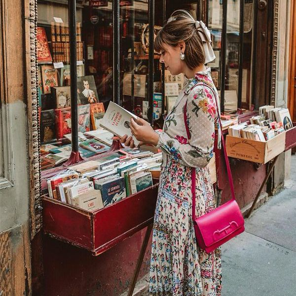 a woman look at a book at a book store