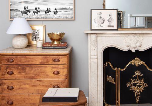 Styled vintage mantle and dresser.