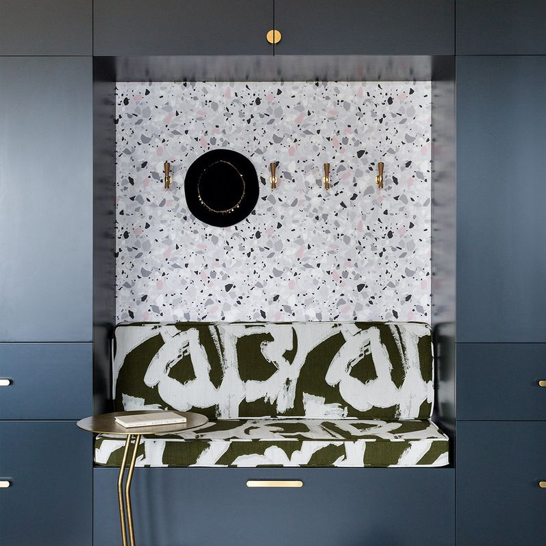 Navy and terrazzo mudroom with drawers