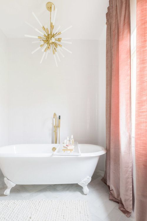 light and airy bathroom with blush curtains and gold sputnik chandelier