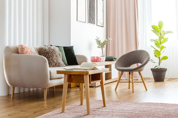 a couch, chair, and table in a living room
