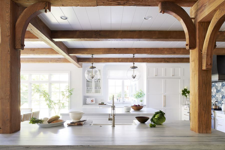 White kitchen with exposed wooden beams