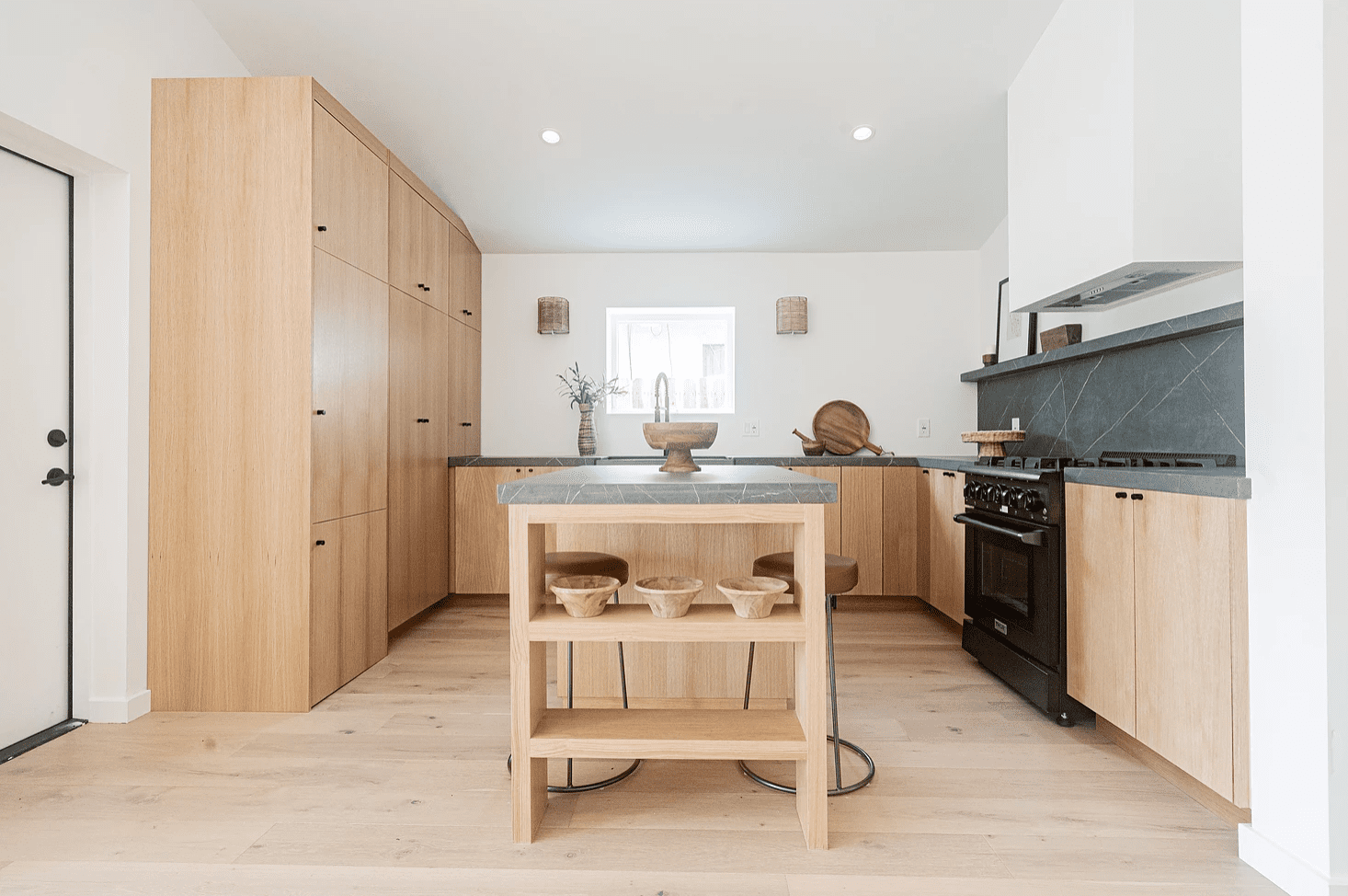 A modern kitchen crafted from wood and marble