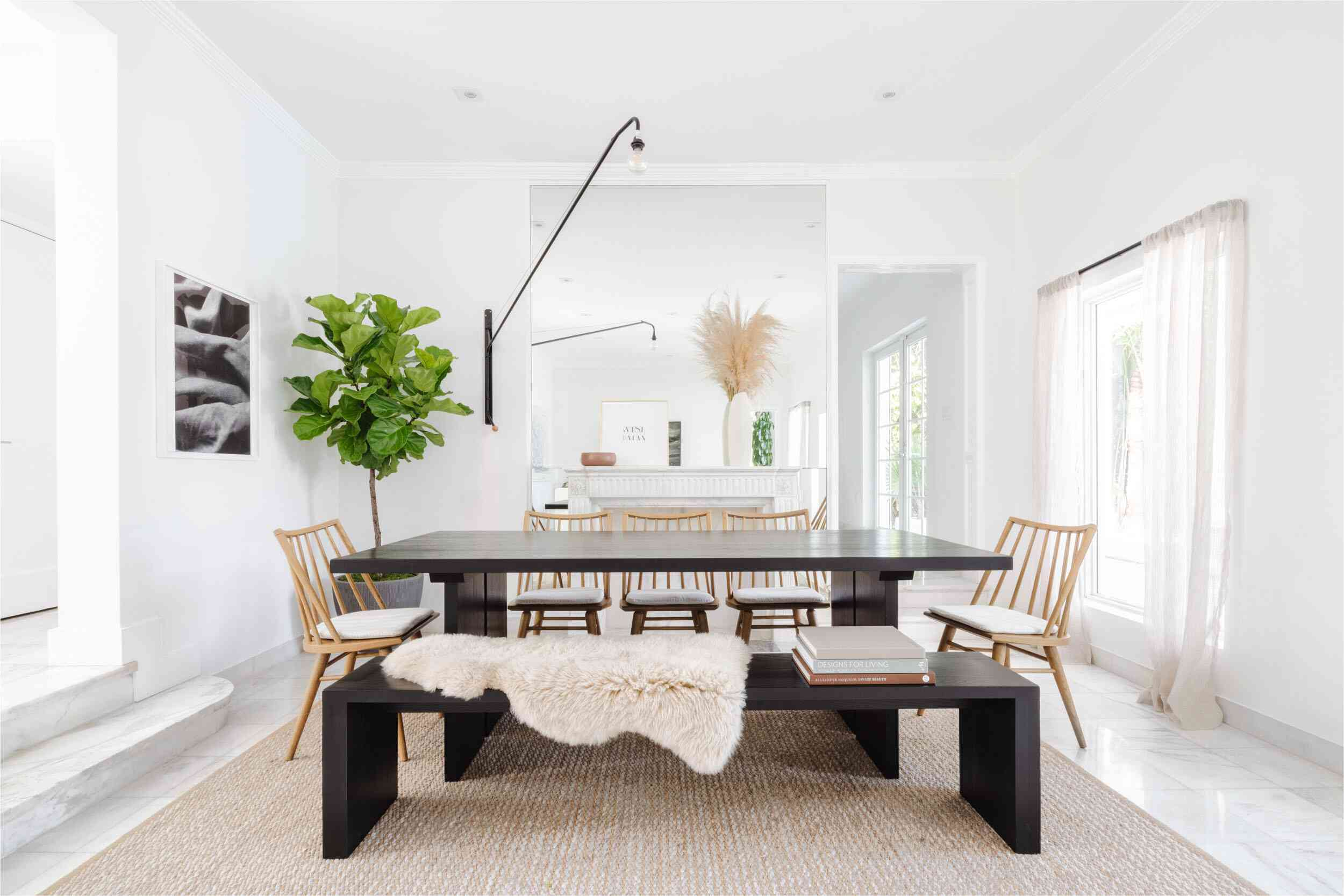 A black dining room table topped with a faux fur throw