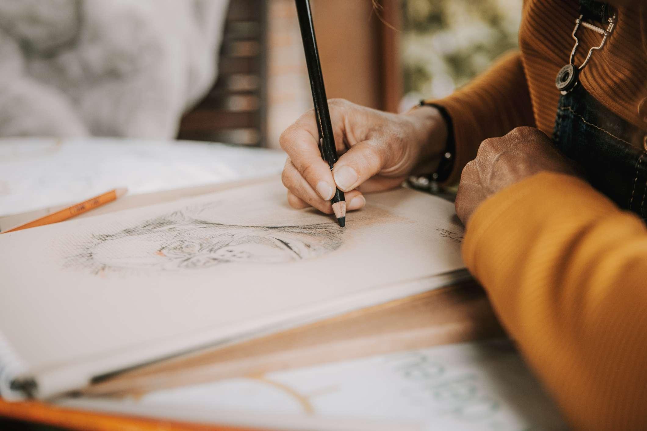 Hands sketching in notepad