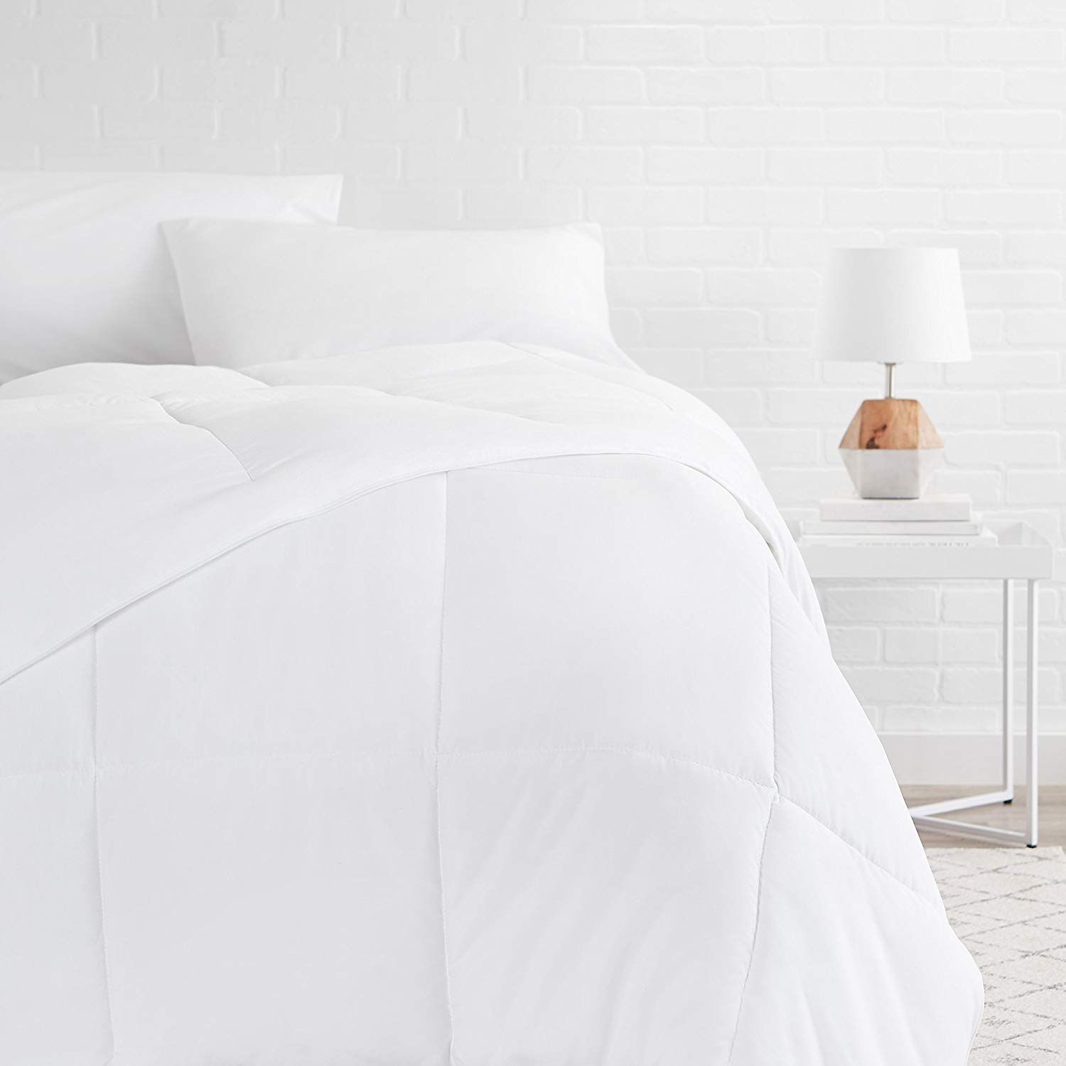 White down comforter on bed
