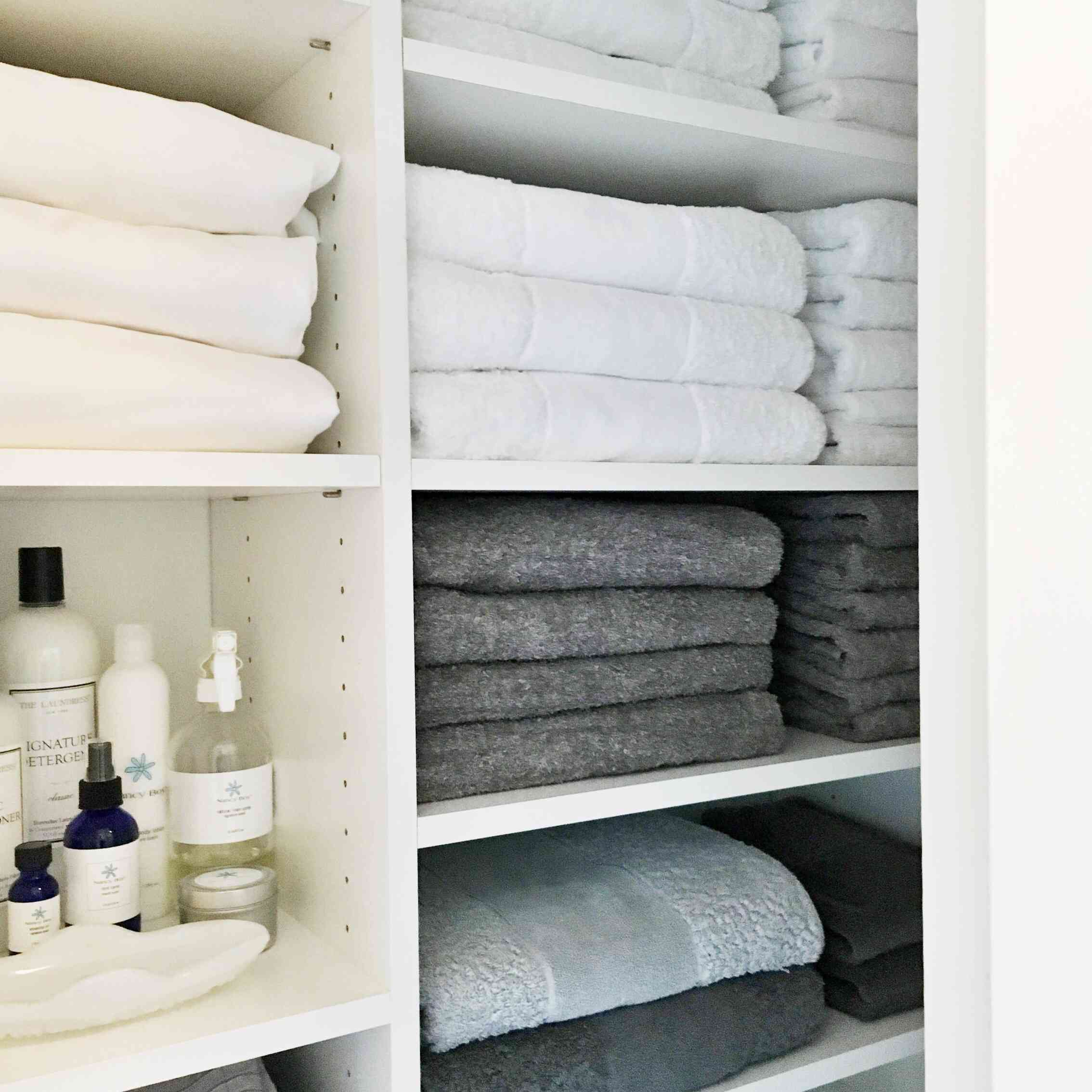 hall closet with matching linens