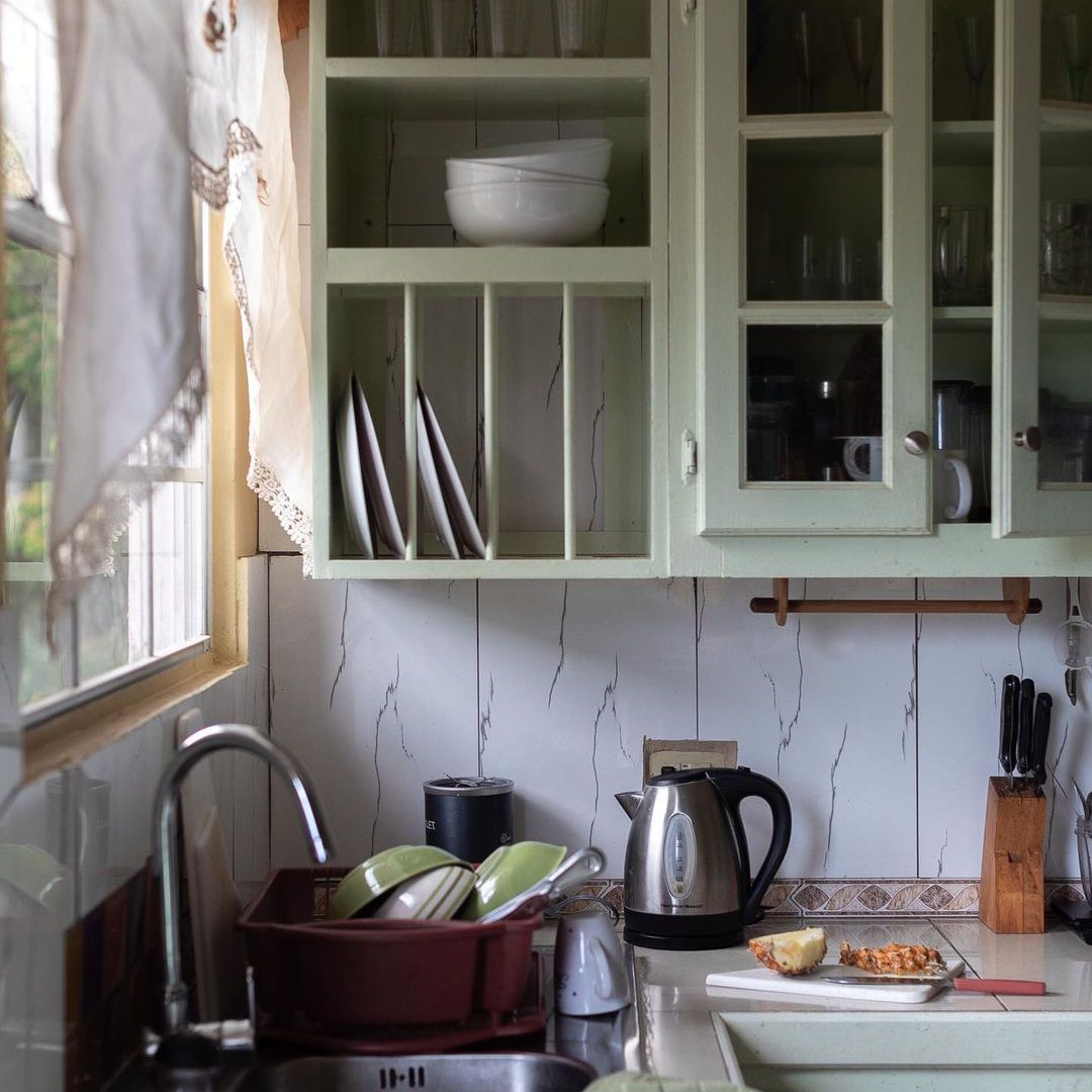 mint green country kitchen shelves with a plate rack