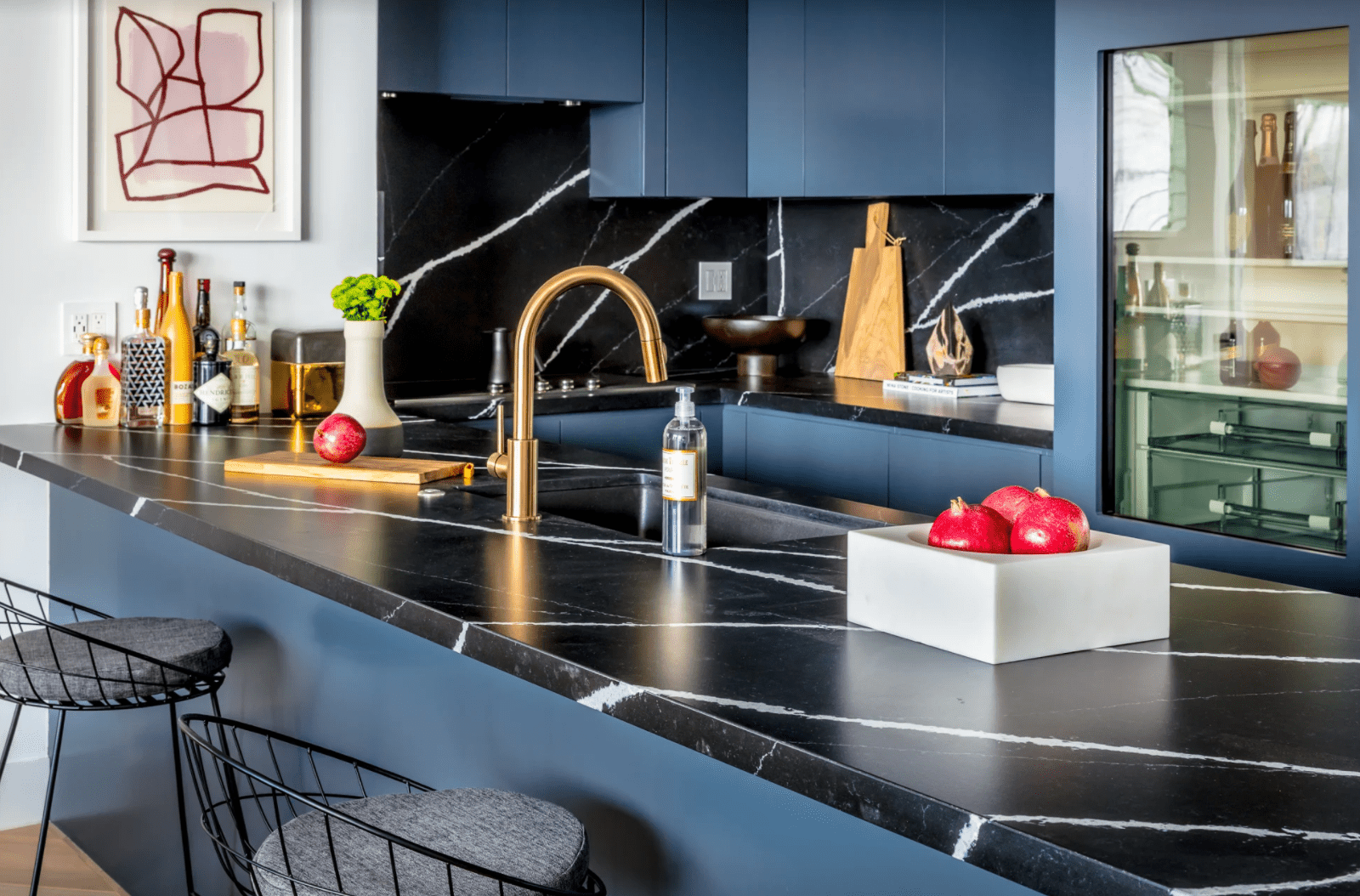 Blue kitchen with marble countertop