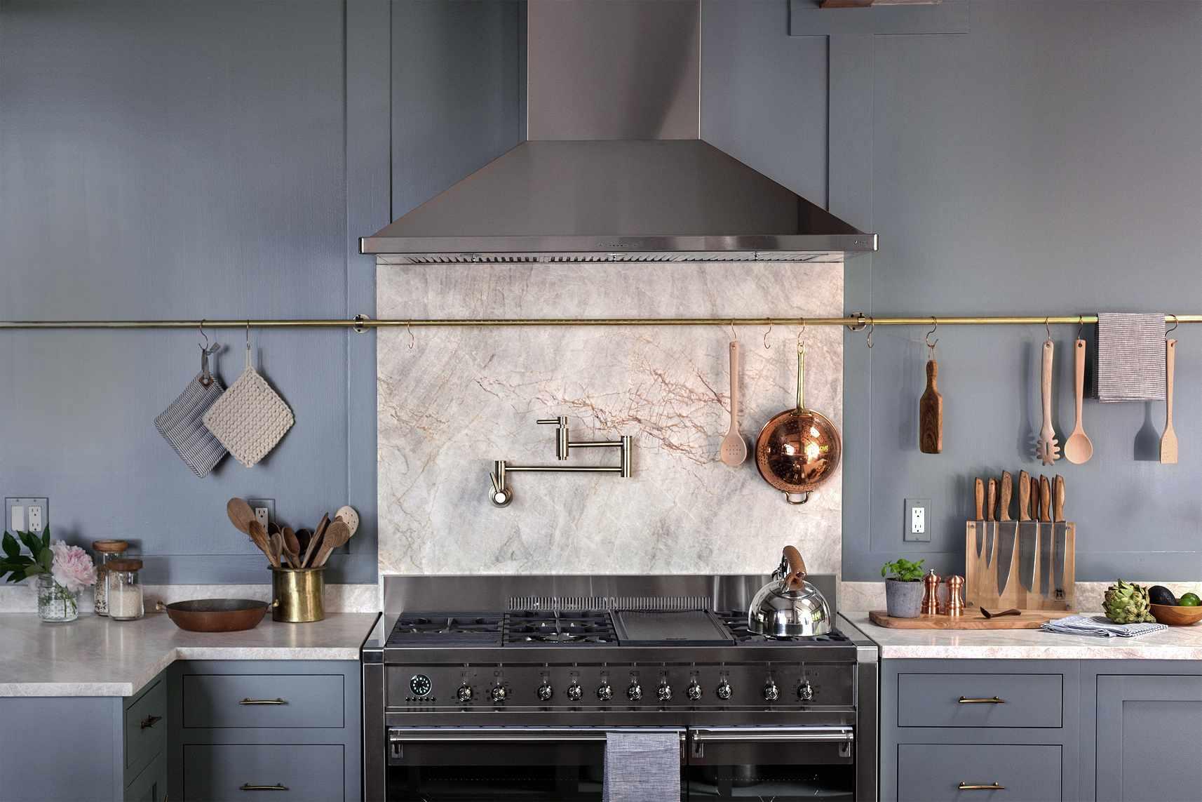 Marble backsplash in a blue gray kitchen