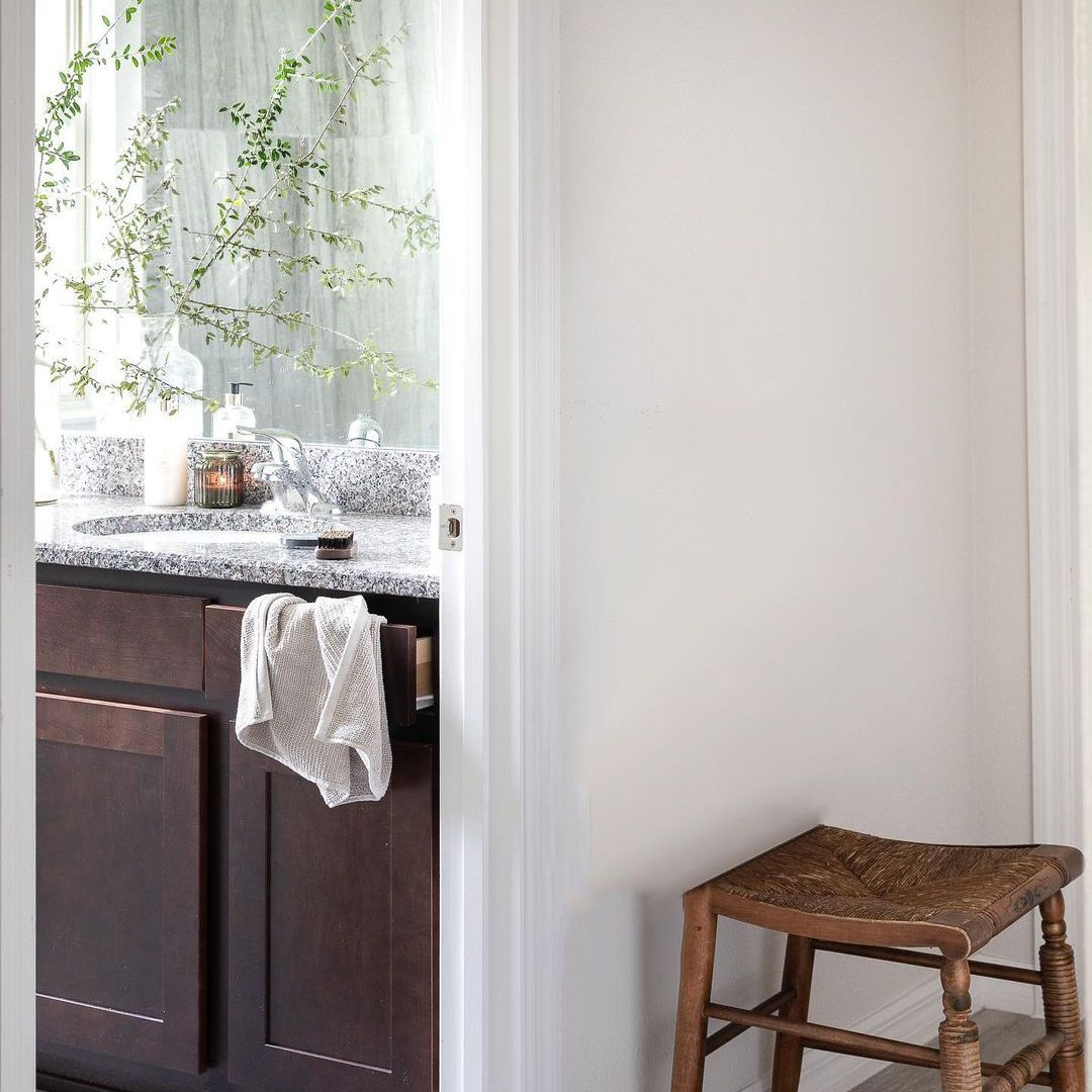 Wooden stool outside of bathroom