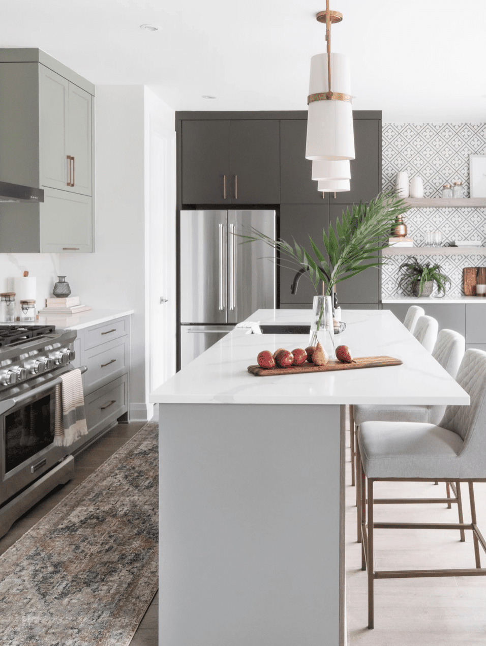 A kitchen with light gray cabinets and dark gray cabinets