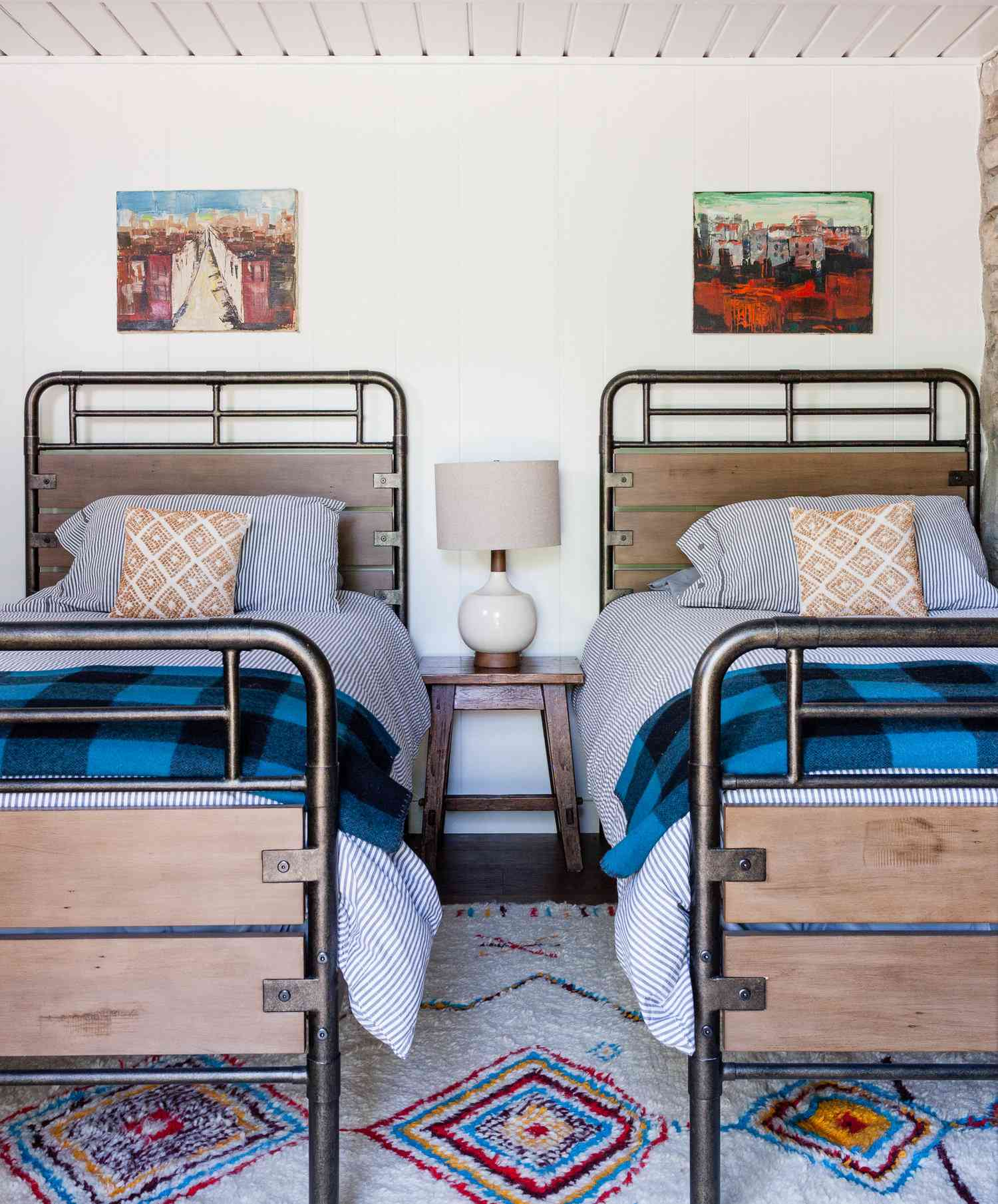 Two twin beds with plaid bedspreads