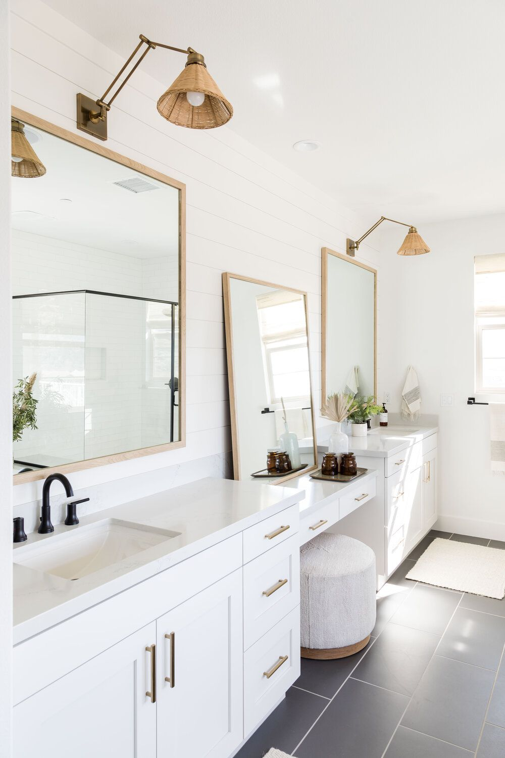 bathroom with double vanity and gold details