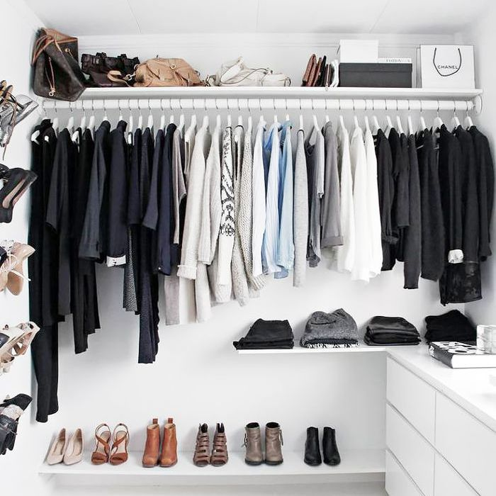 a closet with a gray IKEA rug