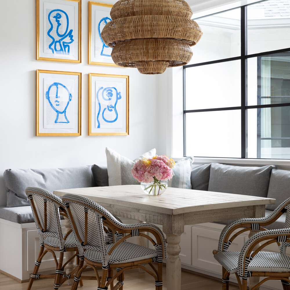 A dining room with a sculptural woven chandelier