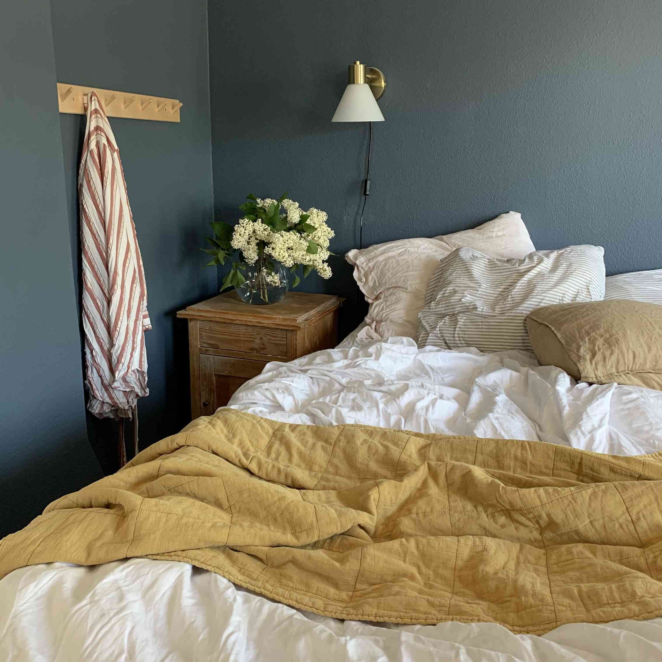 Moody bedroom with mustard accents