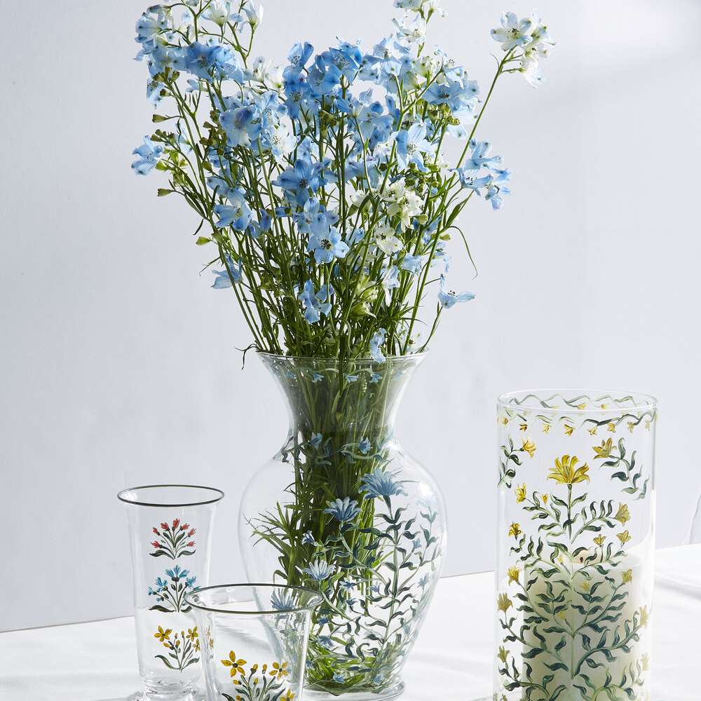 Glass vase filled with flowers.